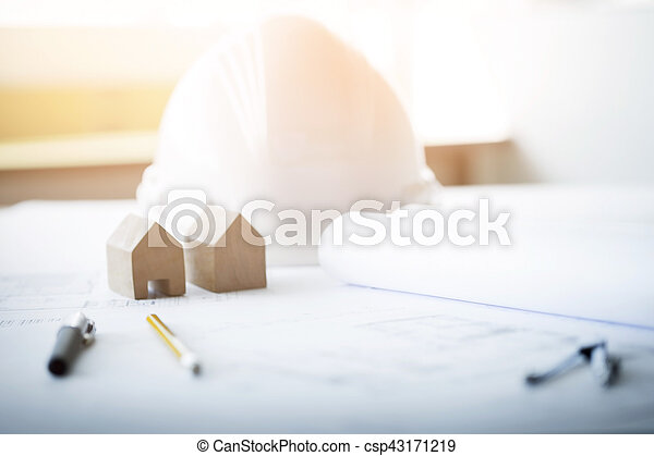 Construction equipment. Repair work. Drawings for building Architectural project, blueprint rolls and divider compass on table. Engineering tools concept. Copy space - csp43171219