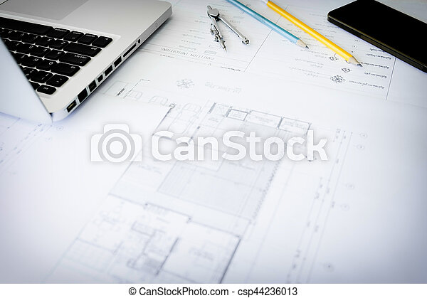 Construction equipment. Repair work. Drawings for building Architectural project, blueprint rolls and divider compass on table. Engineering tools concept. Copy space - csp44236013