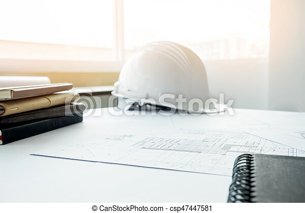 Construction equipment. Repair work. Drawings for building Architectural project, blueprint rolls and divider compass on table. Engineering tools concept with copy space. - csp47447581