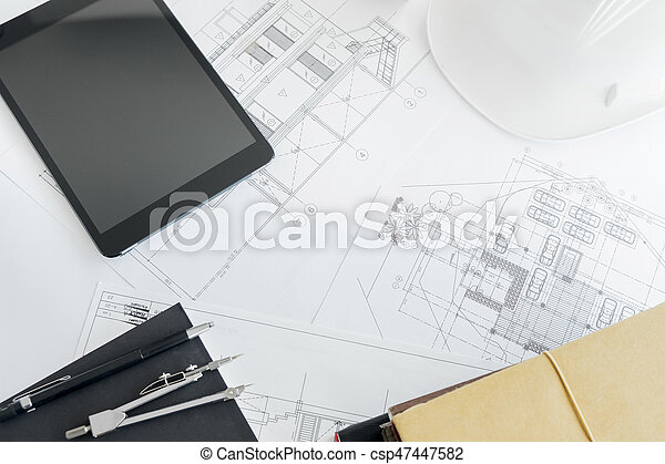 Construction equipment. Repair work. Drawings for building Architectural project, blueprint rolls and divider compass on table. Engineering tools concept with copy space. - csp47447582