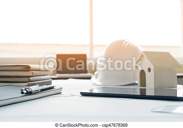 Construction equipment. Repair work. Drawings for building Architectural project, blueprint rolls and divider compass on table. Engineering tools concept with copy space. - csp47678369