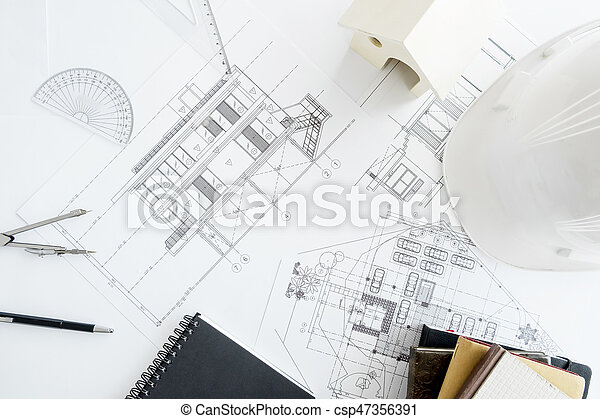 Construction equipment. Repair work. Drawings for building Architectural project, blueprint rolls and divider compass on table. Engineering tools concept with copy space. - csp47356391