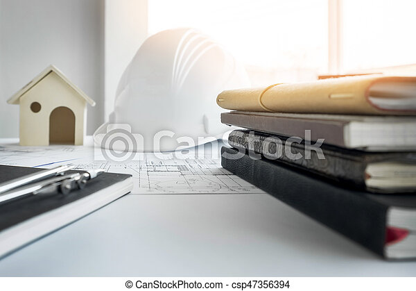 Construction equipment. Repair work. Drawings for building Architectural project, blueprint rolls and divider compass on table. Engineering tools concept with copy space. - csp47356394