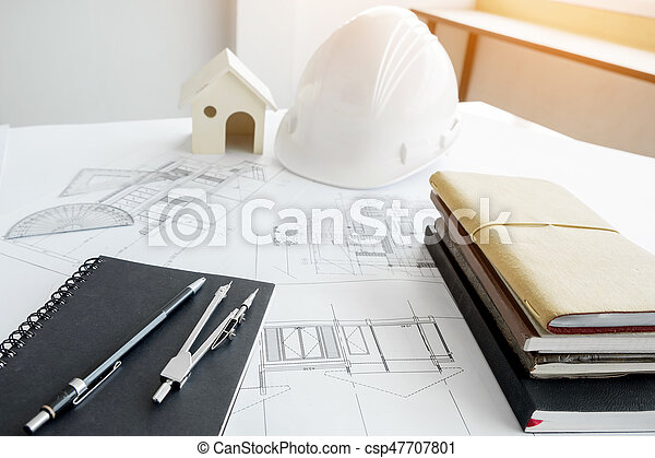 Construction equipment. Repair work. Drawings for building Architectural project, blueprint rolls and divider compass on table. Engineering tools concept with copy space. - csp47707801