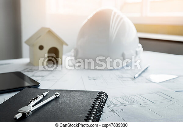 Construction equipment. Repair work. Drawings for building Architectural project, blueprint rolls and divider compass on table. Engineering tools concept with copy space. - csp47833330