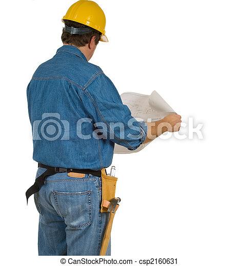 Construction Man reviewing building plans - csp2160631