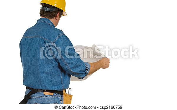 Construction Man reviewing building plans - csp2160759