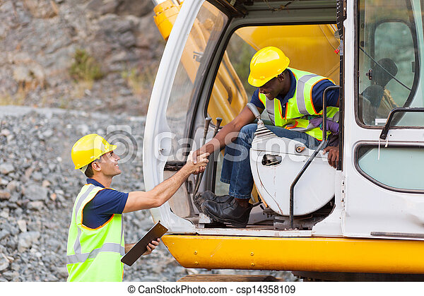 construction manager handshaking with bulldozer operator - csp14358109