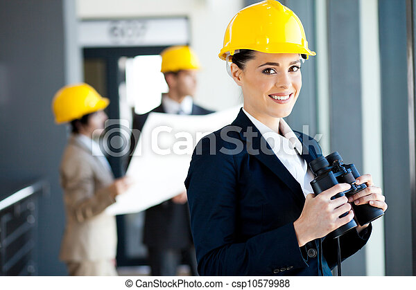 construction manager with binoculars - csp10579988