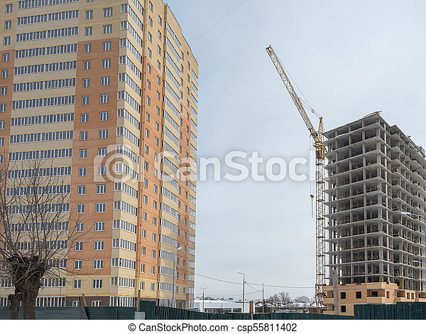 Construction of a modern high-rise residential building - csp55811402