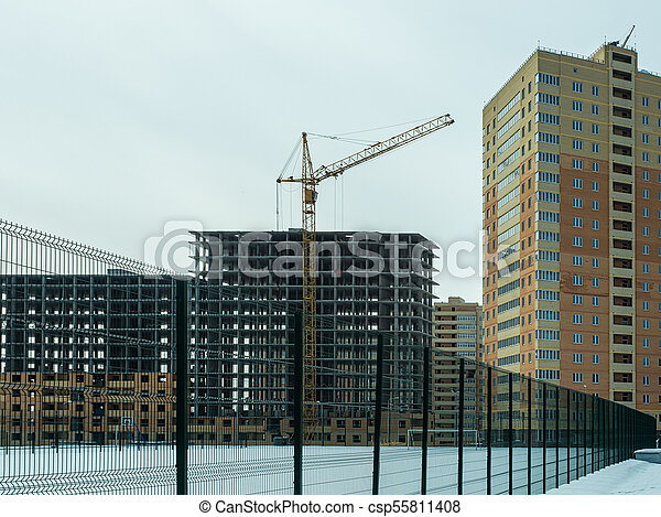 Construction of a modern high-rise residential building - csp55811408