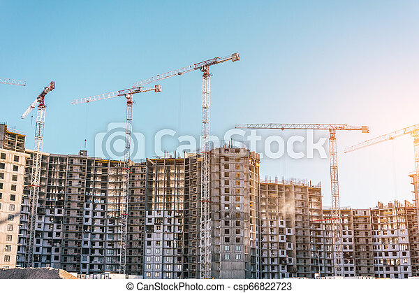 Construction of a residential building and cranes, real estate - csp66822723