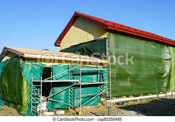 construction of a residential house from blocks, technological treatment of the facade - csp85256485
