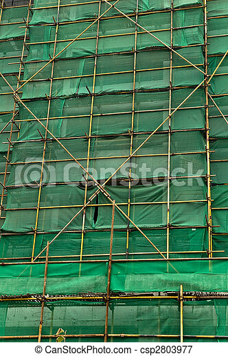 Construction scaffolding and green debris netting abstract background. - csp2803977
