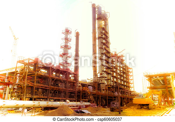 Construction site for the construction of an oil refinery with large  rectification columns at an oil refinery, petrochemical plant