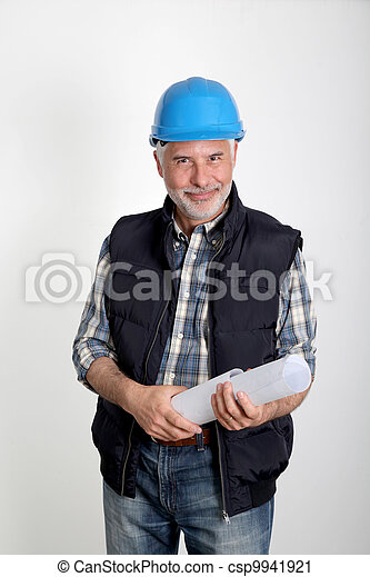 Construction site manager with security helmet - csp9941921