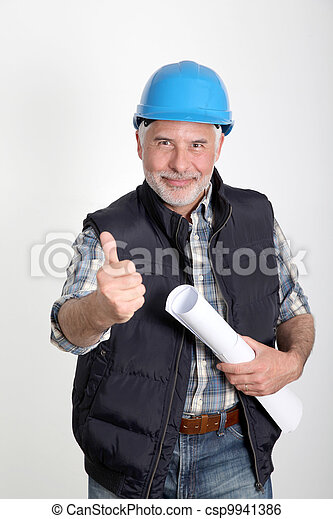 Construction site manager with security helmet - csp9941386