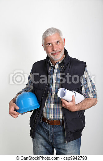 Construction site manager with security helmet - csp9942793