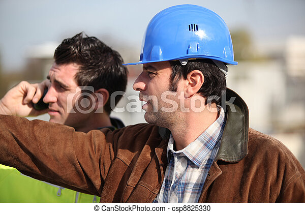 construction supervisor and assistant observing - csp8825330