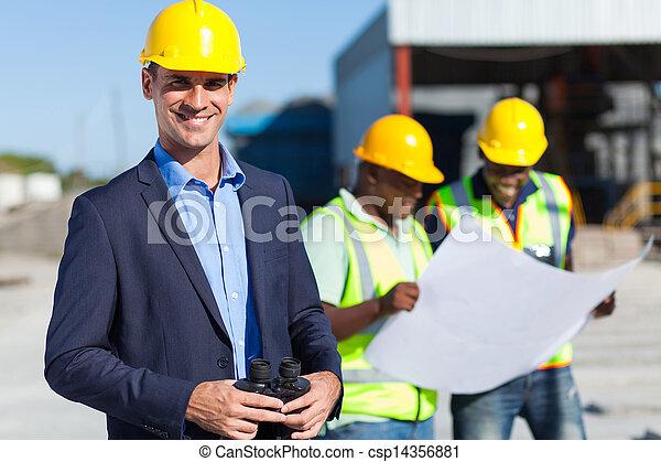 construction supervisor with binoculars - csp14356881