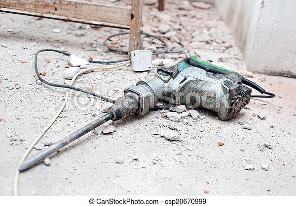 Construction tool, the jackhammer with demolition debris - csp20670999
