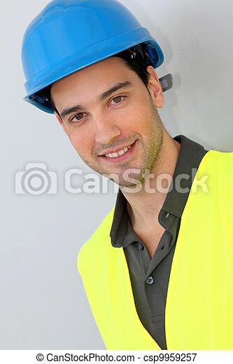 Construction trainee with security helmet - csp9959257
