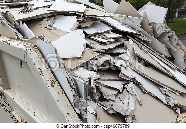 construction waste. plasterboard in container - csp46873789