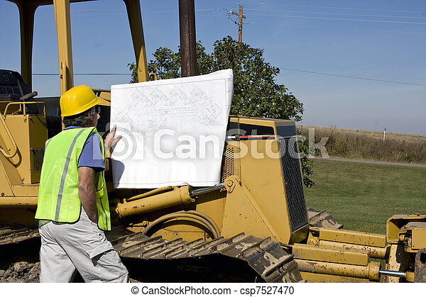 construction worker and dozer - csp7527470