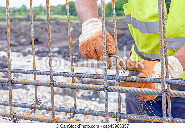 Construction worker binding rebar for reinforce concrete column at the building site - csp43966357