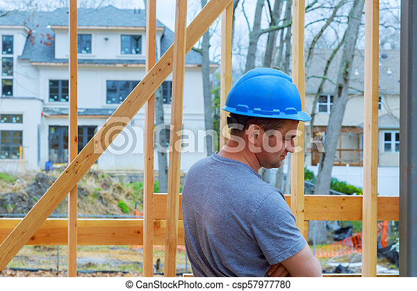 Construction Worker Building Timber Frame New Home - csp57977780