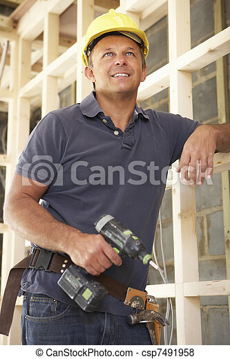 Construction Worker Building Timber Frame In New Home - csp7491958