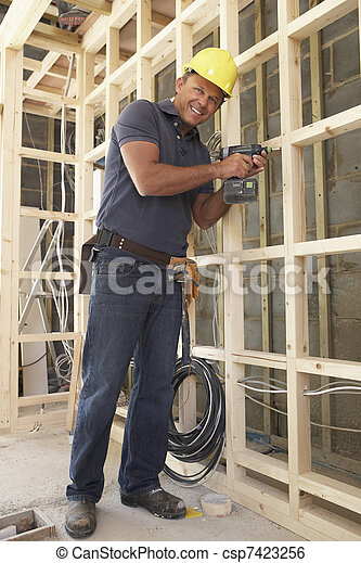 Construction Worker Building Timber Frame In New Home - csp7423256