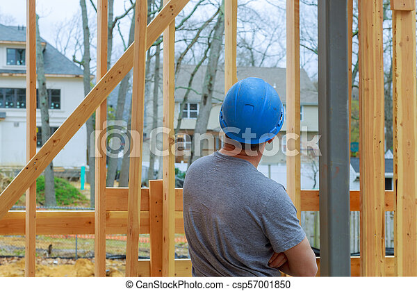 Construction Worker Building Timber Frame New Home - csp57001850