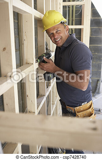 Construction Worker Building Timber Frame In New Home - csp7428740