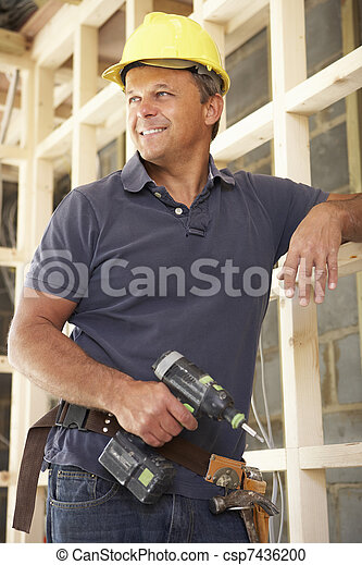 Construction Worker Building Timber Frame In New Home - csp7436200