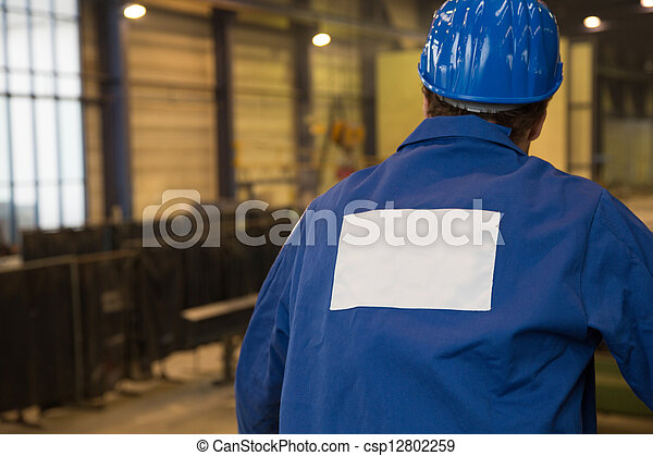 Construction worker in assembly hall - csp12802259