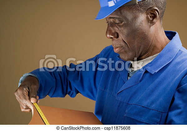 Construction Worker Measuring Tile - csp11875608