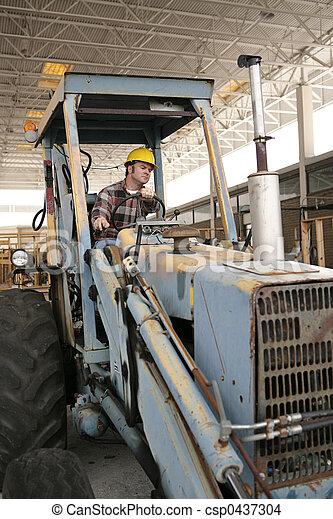Construction Worker on Backhoe - csp0437304