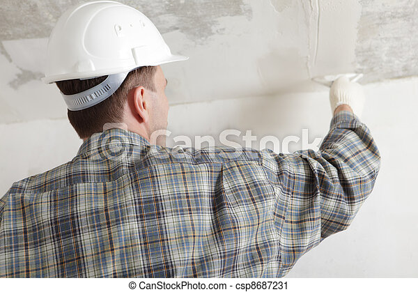 Construction worker plastering the ceiling - csp8687231