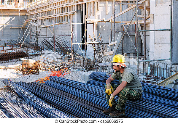 Construction worker resting on steel bars - csp6066375