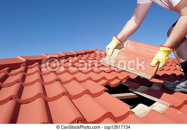 Construction worker tile roofing repair - csp12617134
