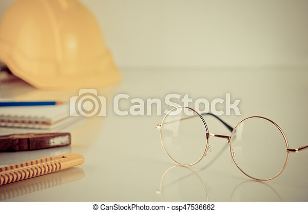 Construction worker tools with eyeglasses on the table - csp47536662