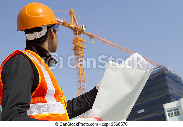 construction worker with crane in background - csp13568570