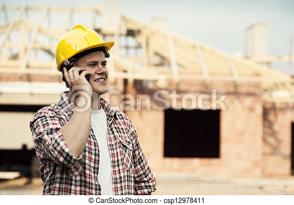 Construction worker with mobile phone - csp12978411