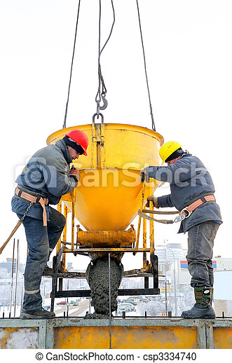 construction workers at concrete work on construction site - csp3334740