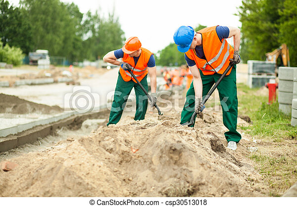 Construction workers digging - csp30513018