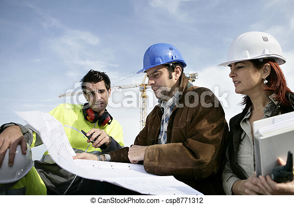 Construction workers discussing plans - csp8771312