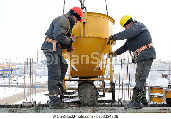 construction workers pouring concrete in form - csp3334736