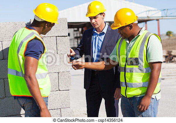 construction workers with their manager checking bricks - csp14356124