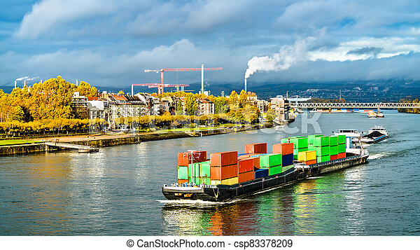 Container ship on the Rhine River in Mainz, Germany - csp83378209